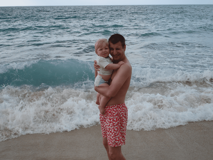 toddler and dad on Lassi beach on the Greek Island of Kefalonia