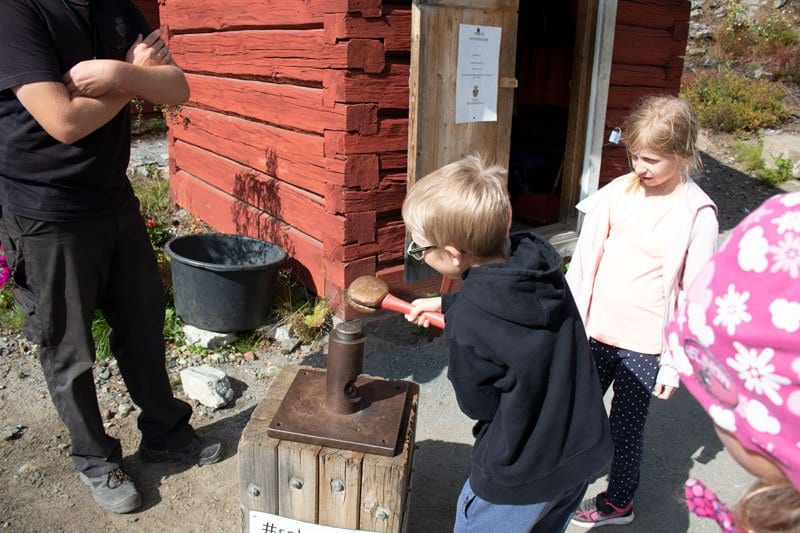 kids minting their own coin at the Kongsberg Silver Museum in Norway