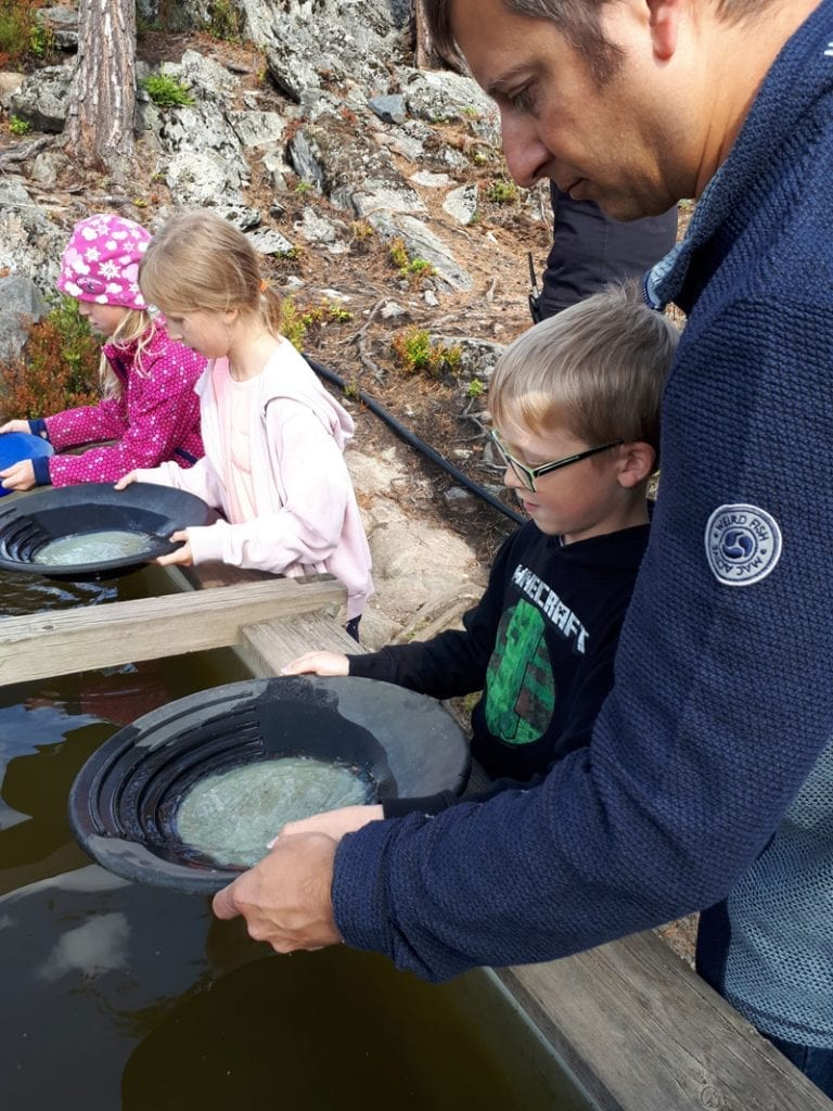 family panning for silver as Kongsbery Silver Mine Museum in Norway