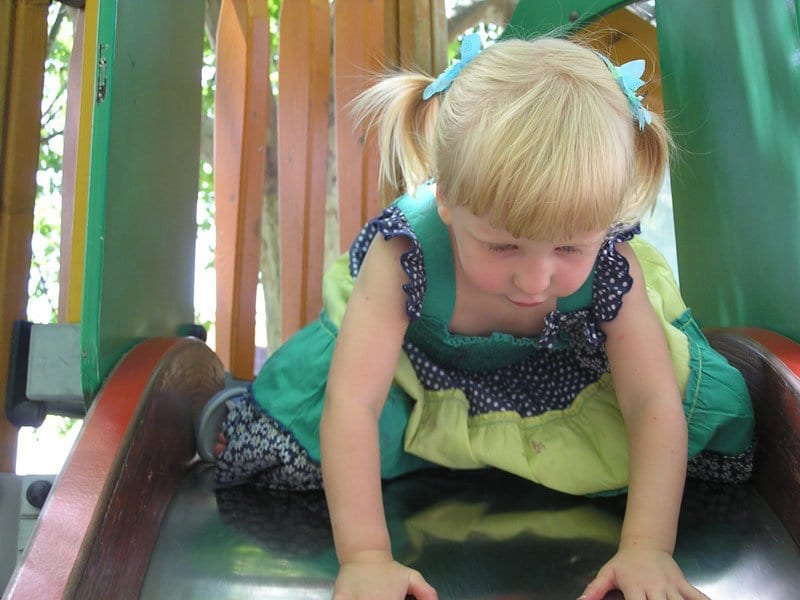 toddler at playground in Pollenca on the island of Mallorca
