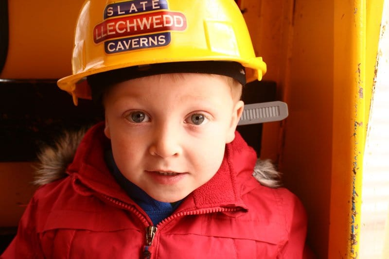 Preschooler heading down in to the mines at Llechwedd Slate Caverns in North Wales
