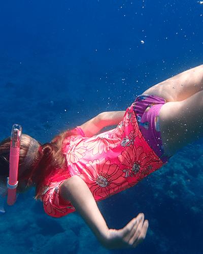 girl snorkelling underwater in the British Virgin Islands