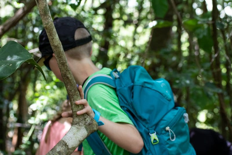 boy wearing the blue bugwatch in the jungle in Mexico