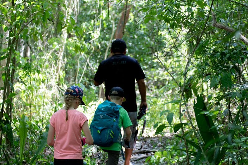 Kids exploring with a guide in the jungle at Punta Laguna Mexico