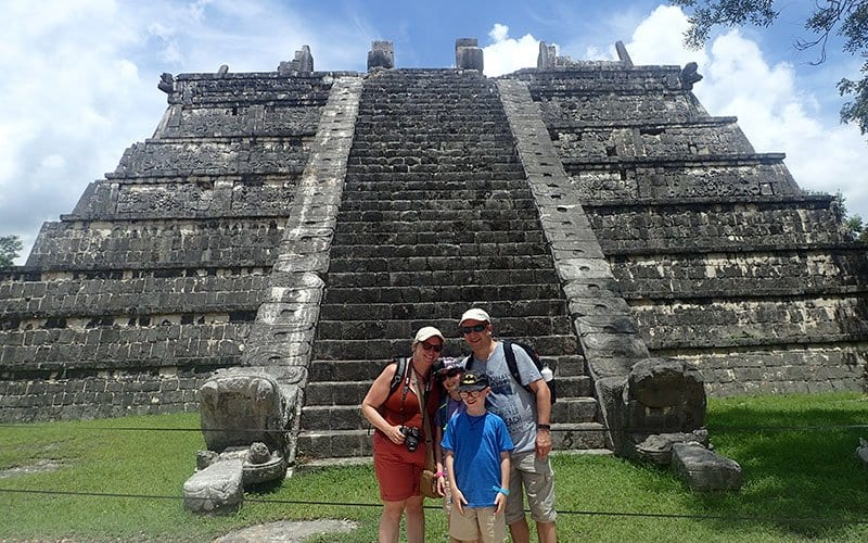family at chichen itza infront of the platform