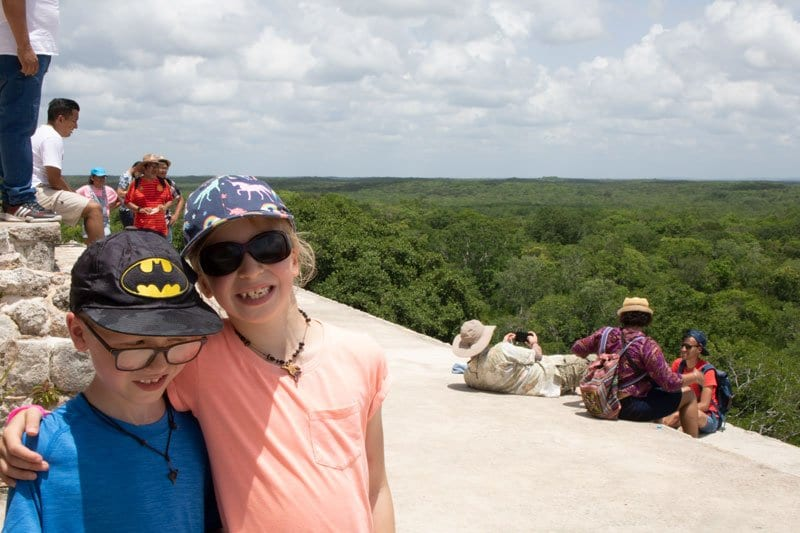 children on top of the great pyramid at Uxmal