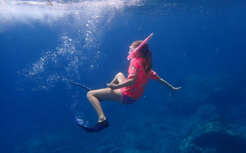 picking the right gear for snorkelling with kids means that they can swim with confidence underwater