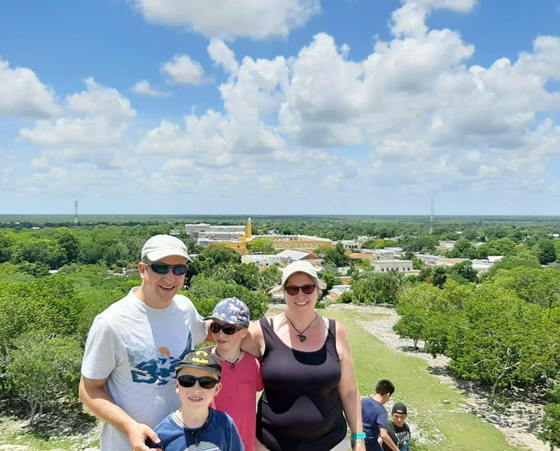 family on top of pyramid in izamal