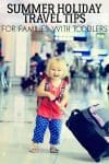 cute toddler girl pulling a suitcase in the airport with text overlay Summer Holiday Travel Ti9ps for Families with Toddlers