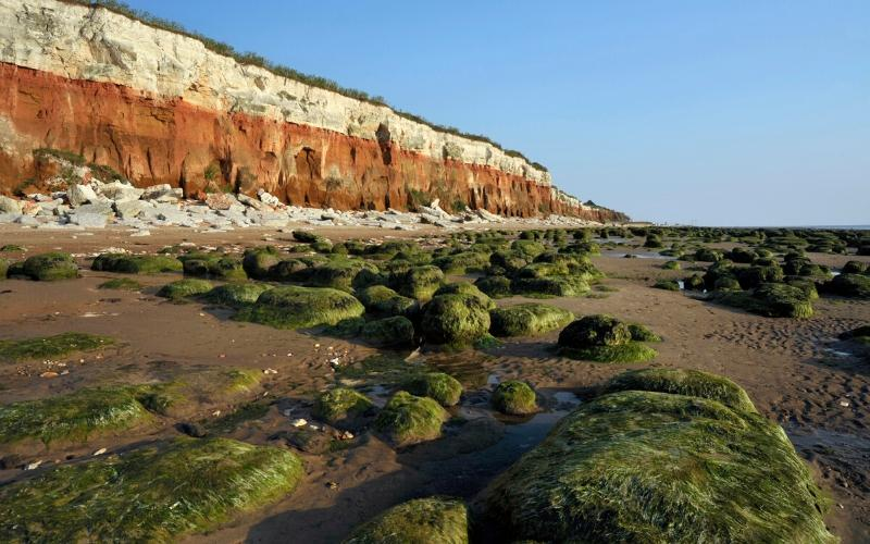 the cliffs at Hunstanton with the wave cut platform in front one of the stops on the North Norfolk Road Trip with Kids